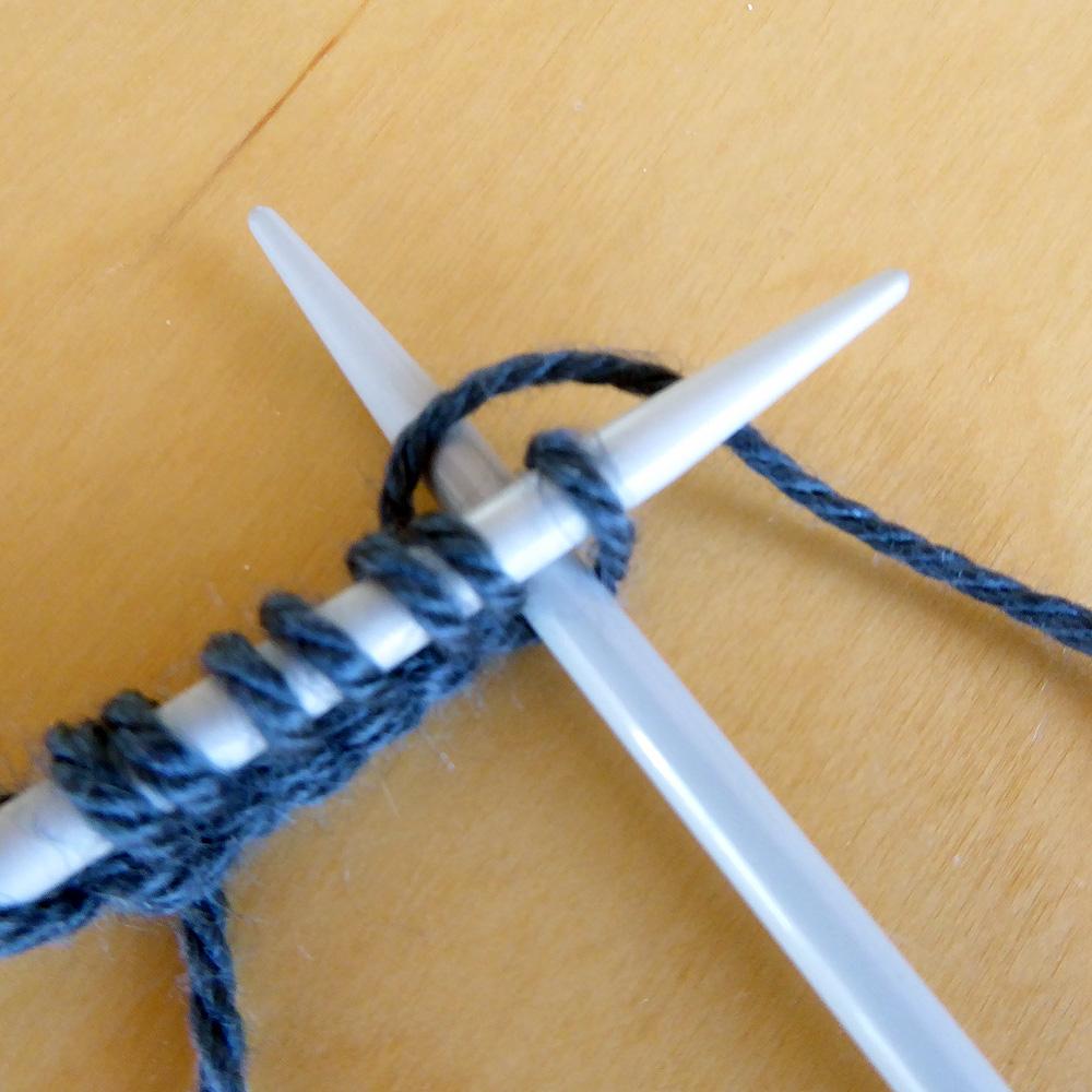 wrap yarn round right hand needle