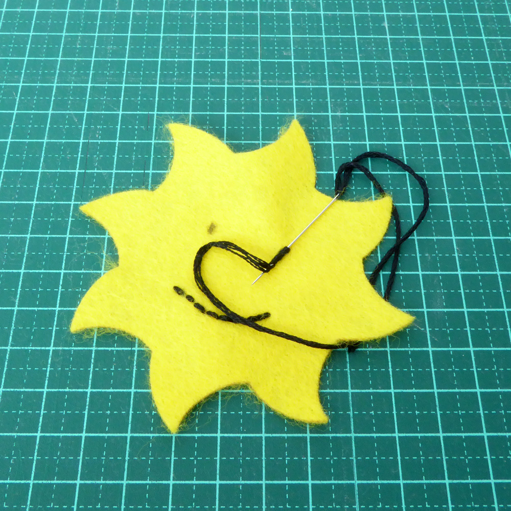 Felt Sun face embroidery
