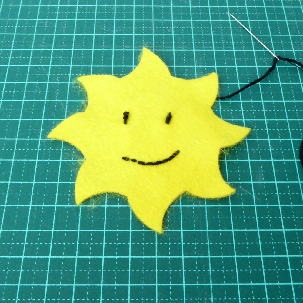 Felt Sun face embroidery