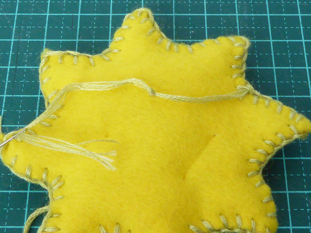 sewing felt sun together